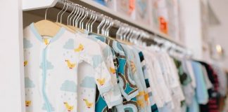 Baby clothes on a rack