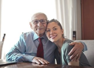 Image indicating a daughter is taking care of her father in his old age